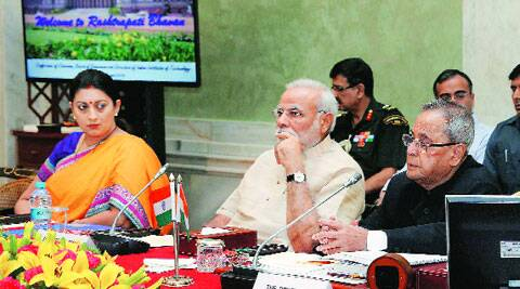 President Pranab Mukherjee, Prime Minister Narendra Modi and HRD Minister Smriti Irani in New Delhi on Friday.(Source: PTI)