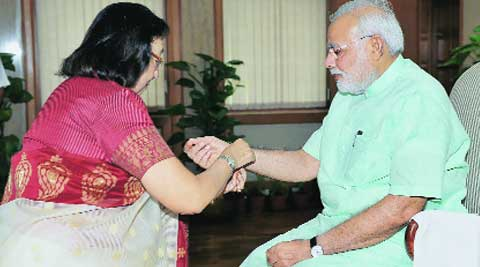 Union Minister Najma Heptulla ties a rakhi on Prime Minister Narendra Modi on Sunday. (Source: PTI photo)