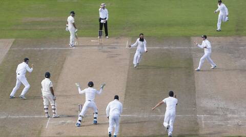 The England team celebrates another Moeen Ali wicket. (Source: AP)