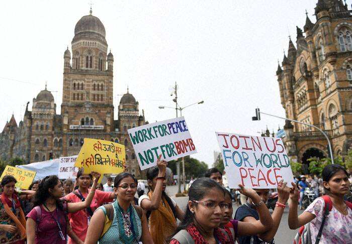 Students participate in a rally to mark the 69th anniversary of atomic bombing at Hiroshima, in Mumbai on Wednesday. (Source: PTI)