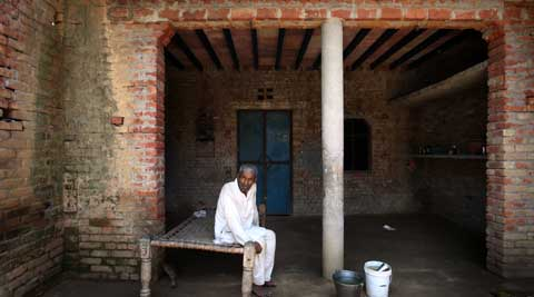 Babu Dheer Singh rests at his new house that he has purchased from one of the persons who left the village during the Muzaffarnagar riots in Kakra Village. (Source: Express photo by Oinam Anand)