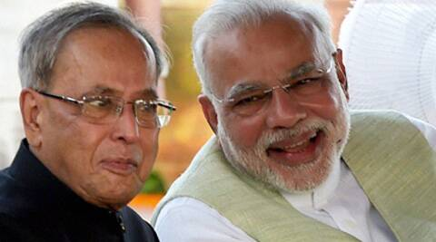 President Pranab Mukherjee shares a light moment with Prime Minister Narendra Modi during the Independence Day celebrations in Rashtrapati Bhawan. (Photo source: PTI)