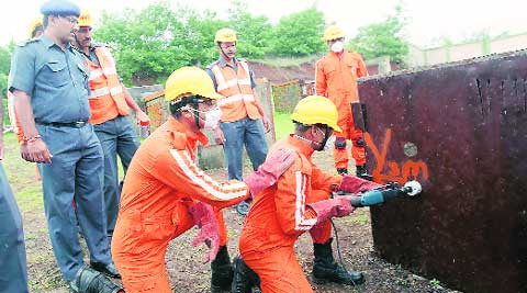 NDRF at a rescue demonstration held for the media on Monday. (Source: Express photo by Sandeep Daundkar)