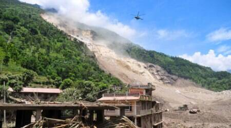 A Nepalese Army helicopter flies over the site of a landslide during a rescue operation in Sindhupalchowk area, about 120 kilometers (75 miles) east of Katmandu, Nepal, Saturday, Aug. 2, 2014. A massive landslide killed at least eight people and blocked a mountain river in northern Nepal on Saturday, causing the water to form a lake that was threatening to burst and sweep several villages, officials said. (Source: AP)