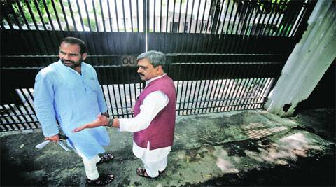 MP Ramesh Bidhuri and Delhi BJP chief  Satish Upadhyay outside L-G's office on Friday. (Express Photo by Praveen Khanna)