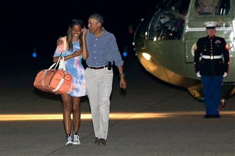 President Barack Obama walks with daughter Malia Obama to board Air Force One at Cape Cod Coast Guard Air Station in Bourne. Source: AP photo