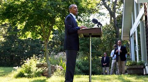 President Barack Obama speaks about developments in Iraq, Monday, from Chilmark, Mass., during his family vacation on the island of Martha's Vineyard. Source: AP Photo