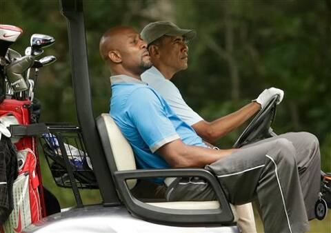 Former NBA basketball player Alonzo Mourning, left, and President Barack Obama, right, ride in a golf cart while golfing at Farm Neck Golf Club, in Oak Bluffs, Mass. Source: AP photo