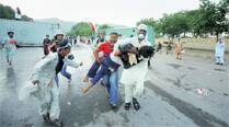 3 dead in protests, Pakistan army meets, says won't back off 'playing itspart'