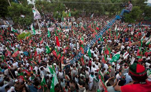 Supporters of Pakistan's cricketer-turned-politician Imran Khan rally in Islamabad, Pakistan, Saturday, (Source: AP photo)