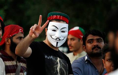 A supporter of Pakistan's cricketer-turned-politician Imran Khan makes victory sign. (Source: AP photo)