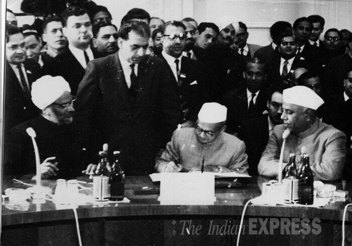 Prime Minister Lal Bahadur Shastri is seen signing the Tashkent declaration on a communique co-signed by Pakistan's President Mohammed Ayub Khan. (Photo: London Bureau Photo)