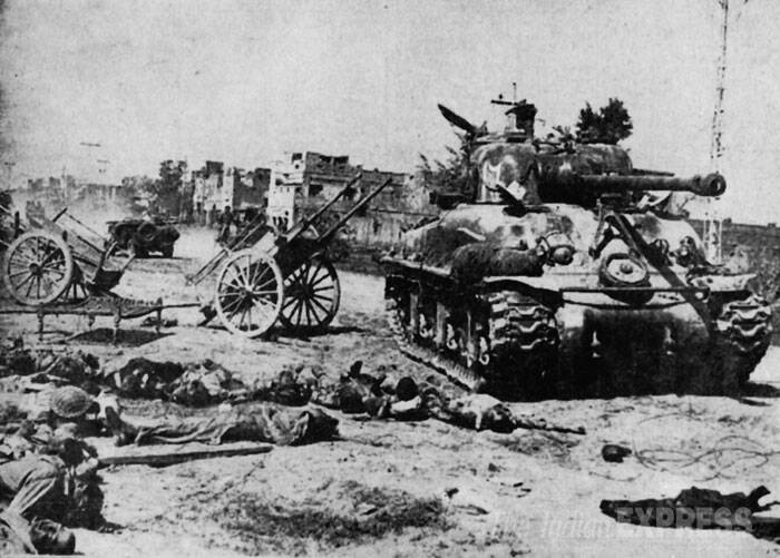 Casualties from Pakistan and a captured tank in Dogral village of the Wagha Lahore sector which was taken by the Indian troops after a fierce fight on September 21 and 22 during Indo-pak 1965 war. (Express archive photo)