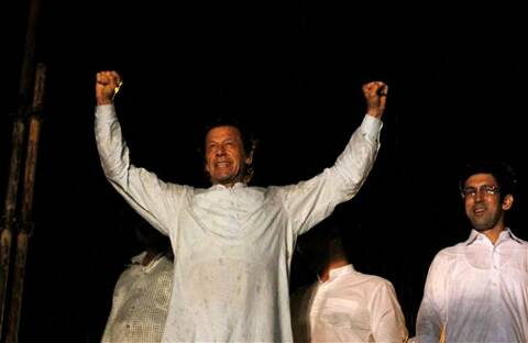 Pakistan's cricketer-turned-politician Imran Khan raises fists during an anti government rally in Islamabad, Pakistan, Saturday, Aug. 16, 2014. Tens of thousands of anti-government protesters gathered in Pakistan's capital Islamabad late Friday. (Source: AP photo)