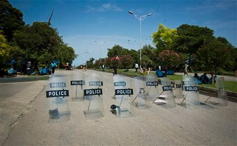 Police leave their shields at a road as the government relaxes its restrictions to stop anti-government marchers in Islamabad, Pakistan. (Source: AP Photo)