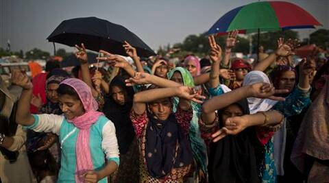 Female supporters of anti-government cleric Tahir-ul-Qadri, dance to the lyrics of a song supporting their leader, during a protest in front of the Parliament building, in Islamabad, Pakistan. Source: AP photo