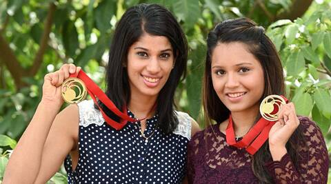 Dipika Pallikal and Joshna Chinappa falunt their gold medals in Chennai. (Source: PTI)