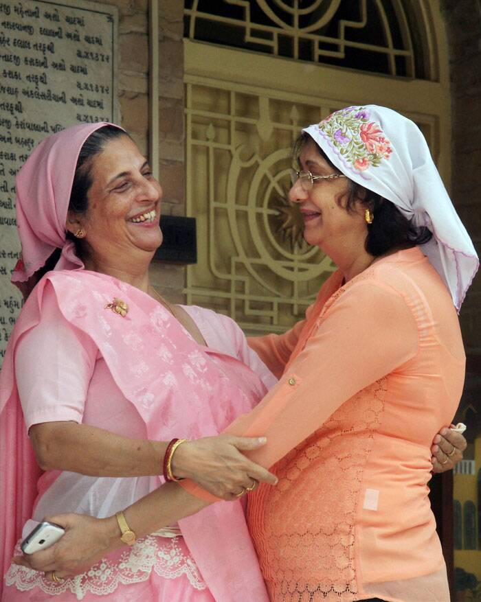 Parsi women greet each other as they celebrate their new year outside Agiary temple in Ahmedabad on Monday. (Source: PTI)