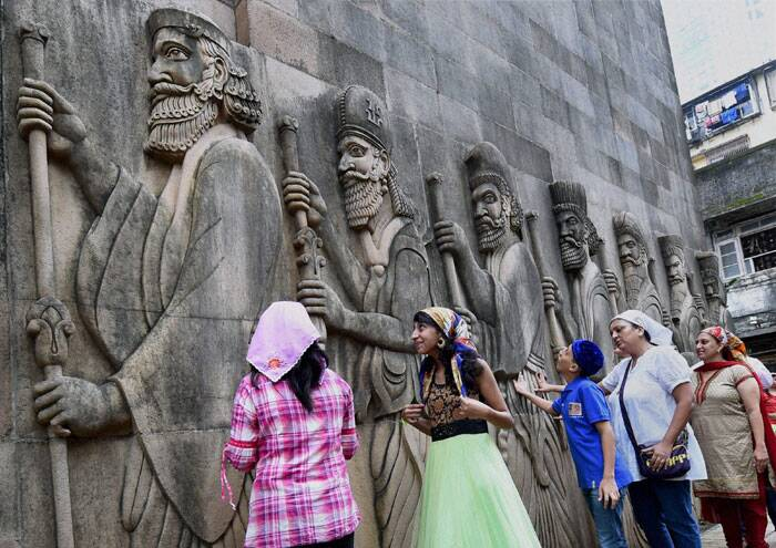 A Parsi family prays outside a fire temple on the occasion of Parsi New Year in Mumbai on Monday. (Source: PTI)