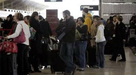 The passengers were left standing out on the tarmac from 4pm to 8pm, while police searched them one by one, said report.