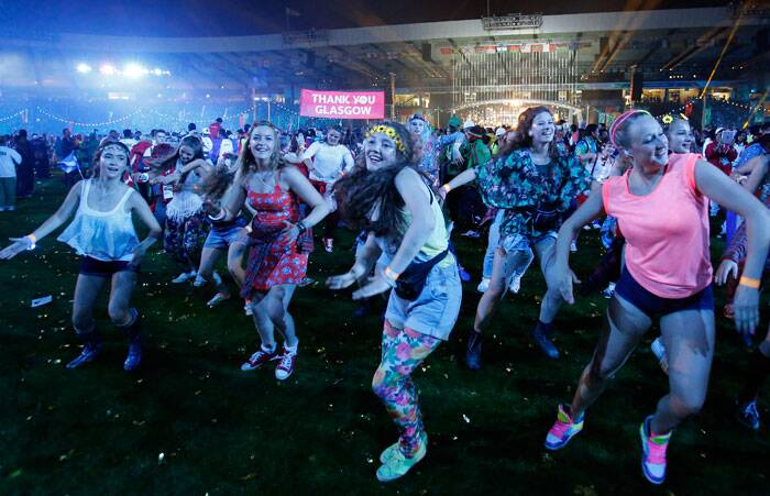 Games-makers and cast members dance during the Closing Ceremony for the Commonwealth Games Glasgow 2014. (Source: AP)