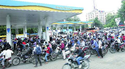 Rush at a petrol pump near RTO that did not take part in the strike on Monday. (Source: IE photo by Arul Horizon)