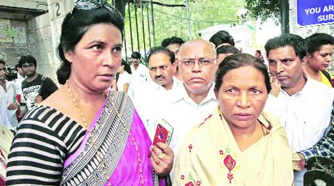 Sher Singh Rana's sister (left) and Phoolan Devi's sister at Patiala House Court Complex in New Delhi on Thursday. (Source: PTI photo)