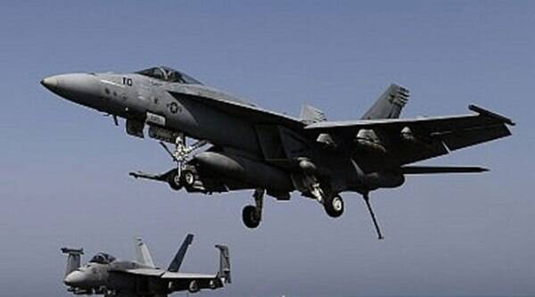 US aircraft conducted coordinated airstrikes against terrorists. (Source: Reuters photo)