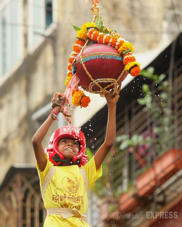 A young boy breaks the dahi handi at Parel, Mumbai. (Source: Express photo by Prashant Nadkar)