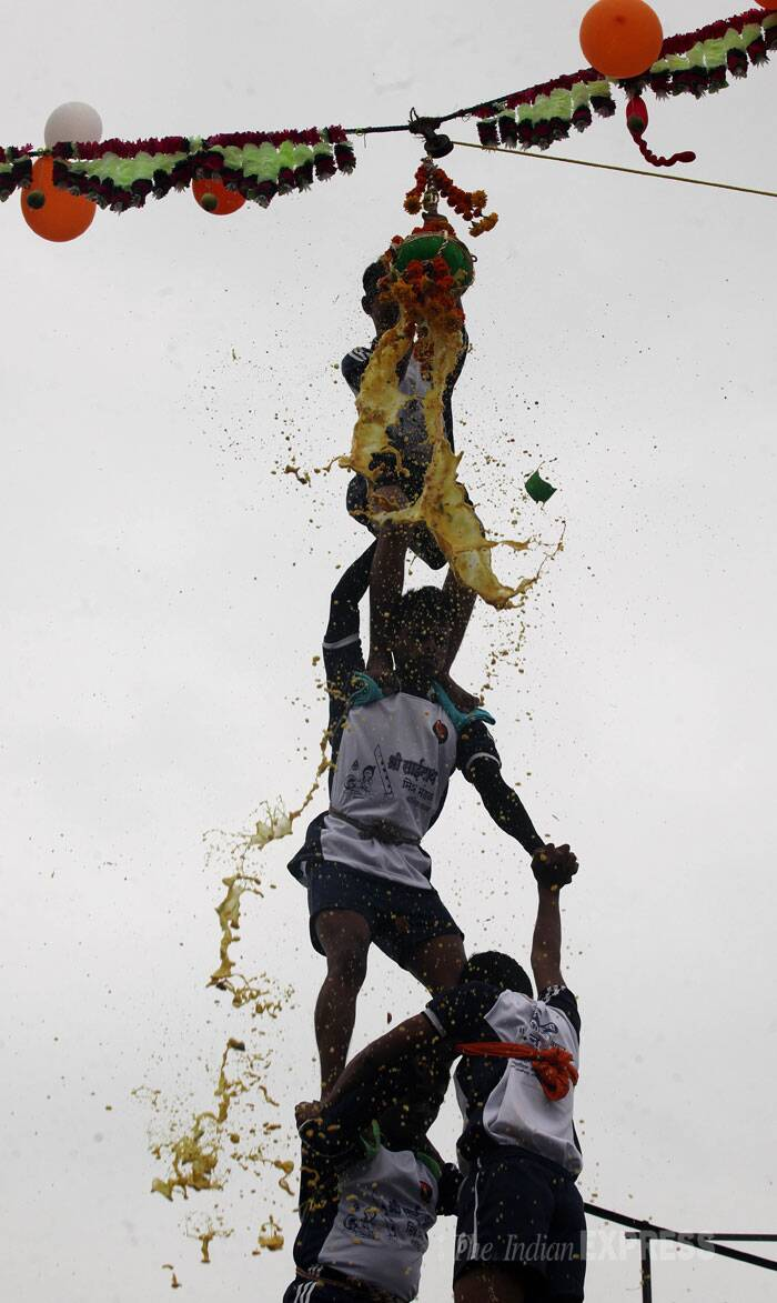 Young boys form a pyramid to break the dahi handi in Mumbai. (Source: Express photo by Prashant Nadkar)