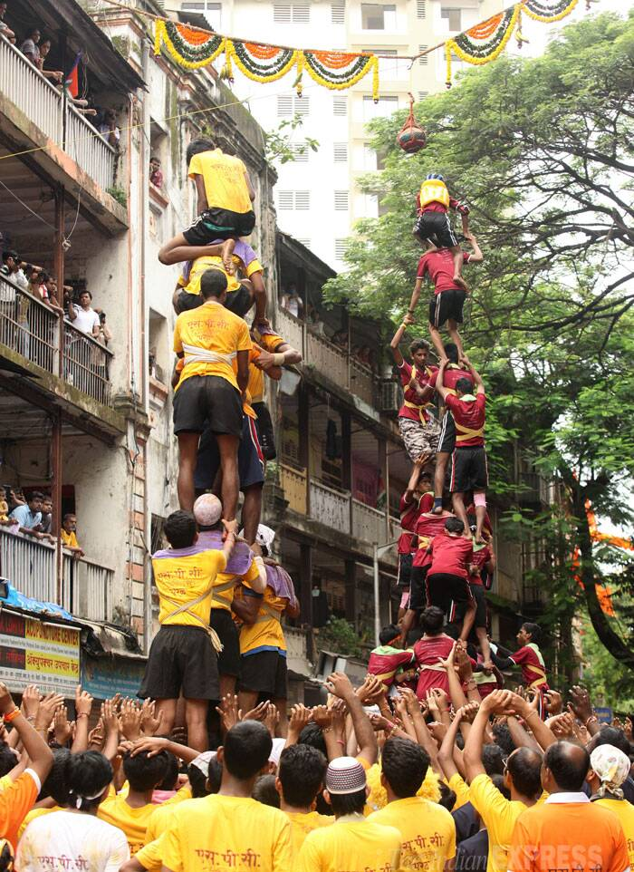 Two teams of young boys form a human pyramid to break the handi. (Source: Express photo by Prashant Nadkar)