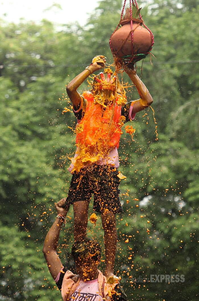 Curd splashes over a boy's face as he successfully breaks the dahi handi in Mumbai. (Source: Express photo by Prashant Nadkar)