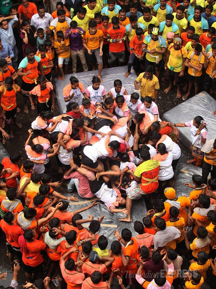 Women try to make a human pyramid to break the handi at Dadar, Mumbai. (Source: Express photo by Prashant Nadkar)