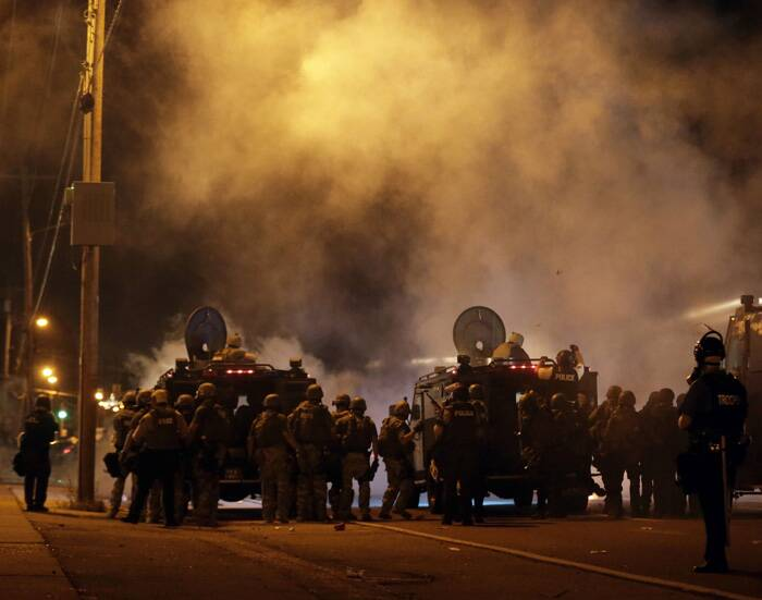 Police attempted to push them back by firing tear gas and shouting over a bullhorn that the protest was no longer peaceful. (Source: AP)