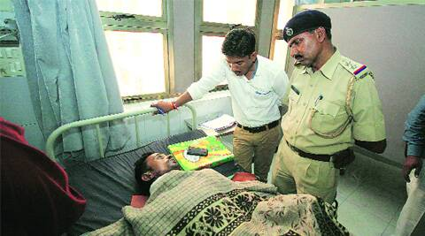 The Vatva police talk to the victim at the LG Hospital.