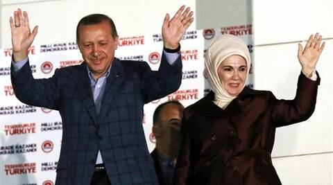 Turkish Prime Minister Recep Tayyip Erdogan and his wife Emine Erdogan acknowledge supporters after Erdogan's election victory, in Ankara, Turkey. Source: AP photo