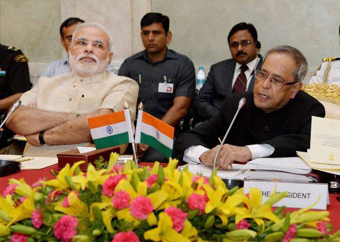 President Pranab Mukherjee addresses conference of Chairmen, Board of Governors and Directors of Indian Institute of Technology at Rashtrapati Bhavan in New Delhi on Friday. Prime Minister Narendra Modi is also seen. (Source: PTI)