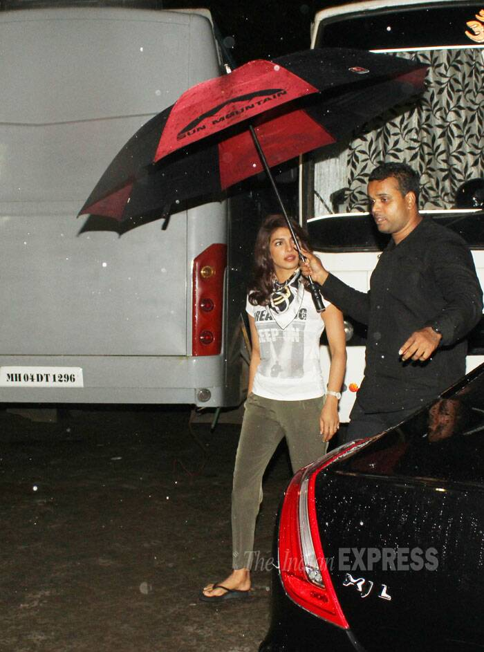 Priyanka Chopra braves the rain in a casual tee shirt, olive green pants and flip-flops. (Source: Varinder Chawla)