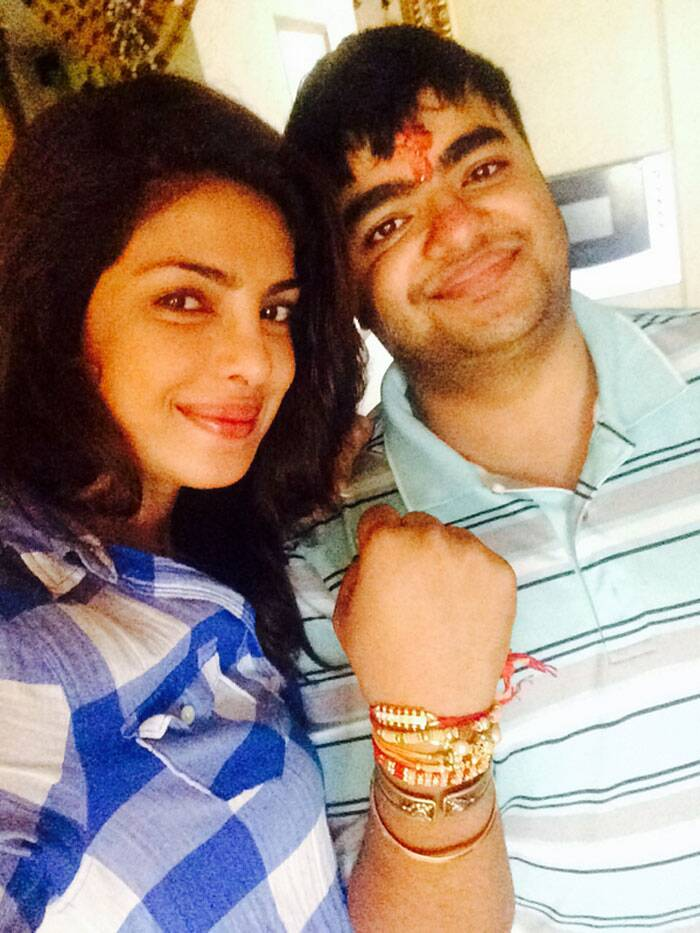 "Priyanka Chopra was also celebrating the special day with her younger brother Siddharth. She tweeted: ""Early morning Rakhi with sid!blessed to have my brothers @irfan525 @BBEAR @shivangchopra99 n the ones not on twitter!""  (Source: Twitter)"