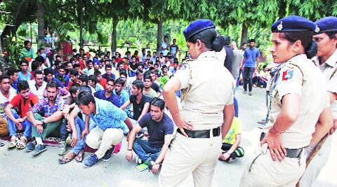Students of PGGC-11 protest against the management at the college campus on Saturday. (Source: Express photo by Kamleshwar Singh)