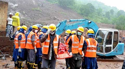 NDRF personnel during rescue operation at the site of a landslide in Malin village in Pune. (Source: PTI)