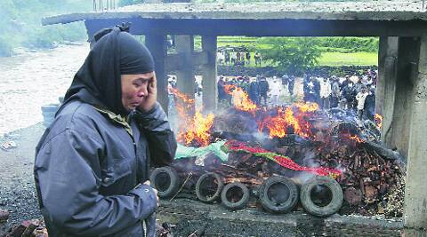 A woman cries next to the pyre of her relative. Source: Pavan Khengre
