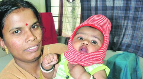 Three-month-old Rudra and mother Pramila Lembhe who survived the landslide likely to be discharged from hospital on Wednesday.  (Source: Express photo by Rajesh Stephen)