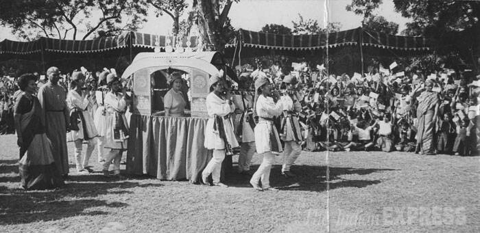 Queen Elizabeth II is seen in a palanquin carried by students of St. Thomas School when she visited the school on the occasion of its Golden Jubilee in Delhi in the year 1983. (Express archive photo)