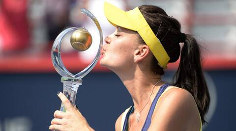Agnieszka Radwanska (POL) with the winner's trophy in the final of the Rogers Cup (Source: USA Today Sports)
