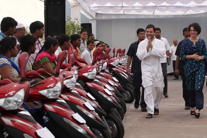 Rahul Gandhi and Priyanka Vadra distribute cycles to the disabled persons at a function organized by Rajiv Gandhi foundation.(Source: Express photo by Renuka Puri)