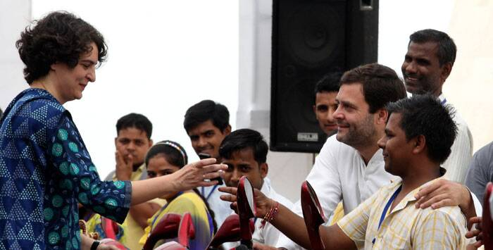 A disabled person  requests Priyanka Vadra to click a photograph with Rahul Gandhi during  a function organized by Rajiv Gandhi  foundation on 23rd Aug. 2014. (Source: Express photo by Renuka Puri)