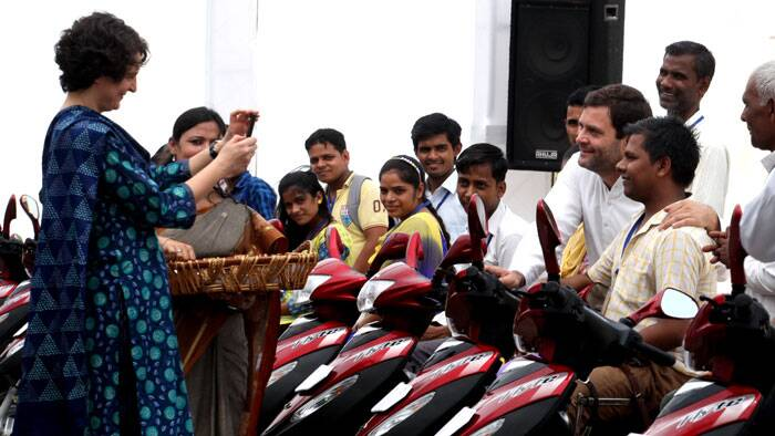 Piyanka Vadra clicking Rahul Gandhi's photo with the disabled persons during a function organized by Rajiv Gandhi foundation on 23rd Aug. 2014. (Source: Express photo by Renuka Puri)