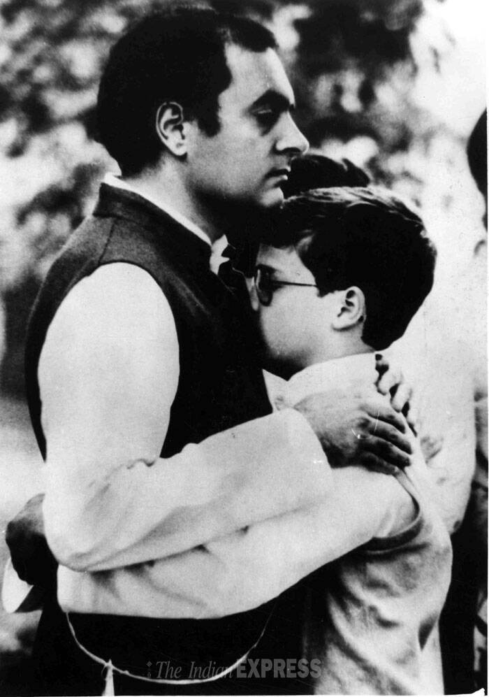 Rajiv Gandhi is seen consoling his young son Rahul Gandhi at the funeral of Indira Gandhi. (Express archive photo)