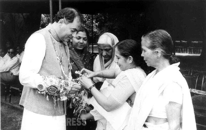 Rajiv Gandhi is seen getting a rakhi tied by women. (Express archive photo)